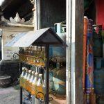 Motor oil is sold on the street in liquor bottles