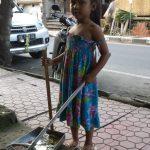 Girl Sweeping in Ubud