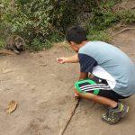 Tyler feeding skeptical monkey